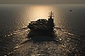 Flickr - Official U.S. Navy Imagery - A helicopter flies the national ensign alongside USS Dwight D. Eisenhower..jpg