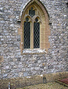 "A flint church - the Parish Church of Saint Thomas, in Cricket Saint Thomas, Somerset, England. The ""bricks"" width varies between 3 and 5 inches (8-13 cm)."