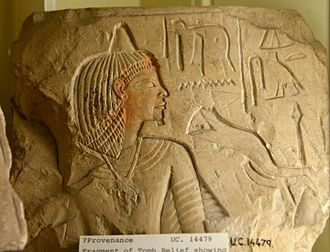 """Opening of the mouth ceremony - Fragment of a tomb relief showing a funerary ritual scene. It depicts meat-offering of the """"opening of the mouth ceremony"""". Late 18th Dynasty. From Egypt. The Petrie Museum of Egyptian Archaeology, London"""