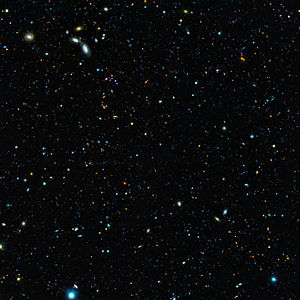 Great Observatories Origins Deep Survey - Composite image of the GOODS-South field, result of a deep survey using two of the four giant 8.2-metre telescopes composing ESO's Very Large Telescope.