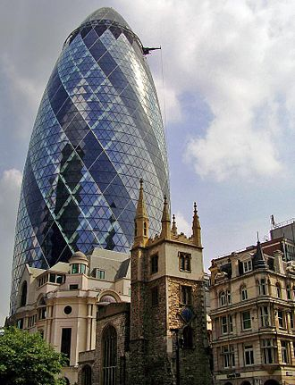 Architecture of England - Norman Foster's 'Gherkin' (2004) rises above the thirteenth century church St Helen's Bishopsgate in London