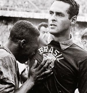 Pelé - Pelé cries on the shoulder of Gilmar dos Santos Neves, after Brazil won the 1958 World Cup.