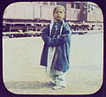 Girl standing; railway train in background LCCN2004707971.jpg