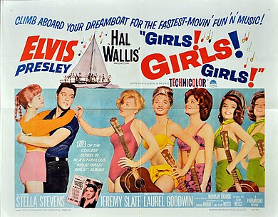 "Film poster with Presley on the left, holding a young woman around the waist, her arms draped over his shoulders. To the right, five young women wearing bathing suits and holding guitars stand in a row. The one in front taps Presley on the shoulder. Along with title and credits is the tagline ""Climb aboard your dreamboat for the fastest-movin' fun 'n' music!"""