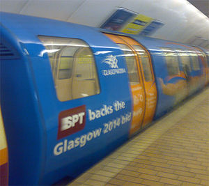 Glasgow Subway - The exterior of a Glasgow Subway car rebranded showing SPT's support for the Glasgow bid for the 2014 Commonwealth Games