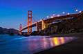 Golden Gate Bridge at night as seen from Marshal beach.jpg