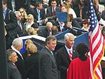 Governor Charlie Crist on his inaugural day conversing with departing Governor Jeb Bush.jpg