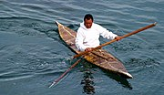 Inuit seal hunter in a kayak, armed with a harpoon.