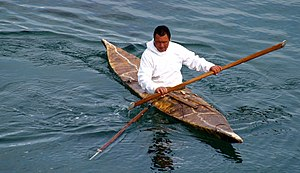 Sea kayak - Inuit seal hunter in a kayak, armed with a harpoon.