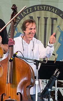 Greg Cohen with Masada String Trio in concert (14634760797) (cropped).jpg
