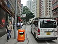 HK Sai Ying Pun 皇后大道西 Queen's Road West carpark TVB Toyota Hiace white motorvan tail n orange peel bin Apr-2013.JPG