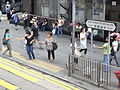 HK Tram tour view Central Des Voeux Road sign salesladies.JPG