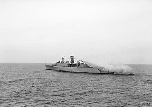 HMS Devonshire (D02) - A Seaslug missile roars away from HMS DEVONSHIRE's twin launcher for the first time. At this early stage of firing, the boosters can be seen still attached to the weapon, May 1962