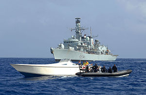HMS Iron Duke (F234) - Iron Duke intercepting a suspected smuggling vessel in the Caribbean.