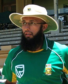 A portrait of a bearded man wearing South African ODI uniform