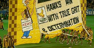 Hawthorn Football Club - Hawks players run through the banner in a 2007 semi-final against the Kangaroos, led by then-captain Richard Vandenberg in his final game.