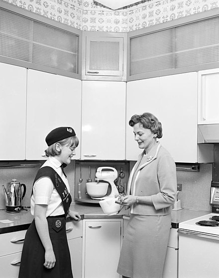 Home economist Mary Norris with a Girl Scout, Seattle, Washington, 1966