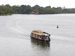 A House boat floating on Ashtamudi Lake- Scene from Thevally