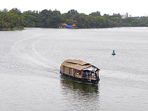 Thevally - A House boat floating on Ashtamudi Lake- Scene from Thevally
