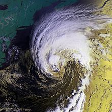 Satellite imagery showing a poorly-formed hurricane at its strongest northwest of Bermuda