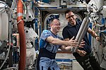 ISS-54 Alexander Misurkin and Joe Acaba work inside the Destiny lab.jpg