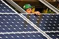 Installing solar panels (3049033225).jpg