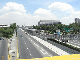 Mexico City Metrobús - Southern section of Avenida de los Insurgentes seen from a bridge of the Periférico near the Perisur Mall, showing the Perisur MB station
