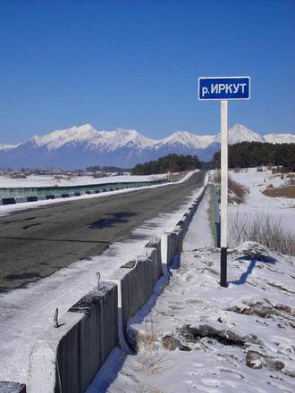 Irkut River - Road sign Irkut River near the village Zaktuy in Tunkinsky District of Buryatia (2005)