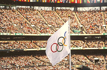 The Olympic flag waves at the 1996 games. JO Atlanta 1996 - Drapeau.jpg