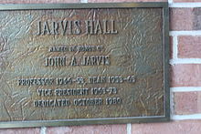 This is a picture of the plaque dedicated to John A. Jarvis. He was a professor, dean, and vice president of UW-Stout. The plaque is located in Jarvis Hall in Menomonie, WI.