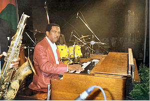 Organ trio - Jazz organist Jimmy Smith at a show in Italy in 1994; the sax and drumkit of the other trio members can be seen in this picture.