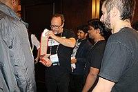 Jnanaranjan Sahu offering a traditional handicraft from Odisha to Jimmy Wales at Wikimania 2018 (42972551264).jpg