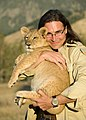 John Banovich, with Lions, Audrey Hall photoshoot.jpg