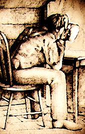 Smith seduto su una sedia di legno con la faccia in un cappello