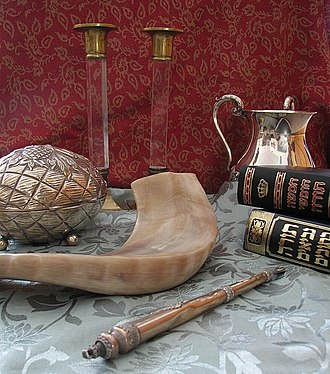 Judaism - Judaica (clockwise from top): Shabbat candlesticks, handwashing cup, Chumash and Tanakh, Torah pointer, shofar and etrog box