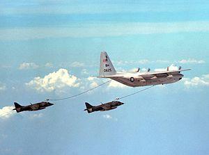 VMGR-252 - A VMGR-252 KC-130R refueling two Harriers, in 1978.
