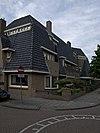 foto van Bouwblok met vier woningen in Amsterdamse School-stijl