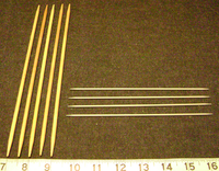 Double-pointed knitting needles usually come in sets of four (US size 1, on right) or five (US size 8, on left).