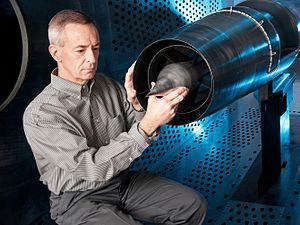 Sonic boom - New research is being performed at NASA's Glenn Research Center that could help alleviate the sonic boom produced by supersonic aircraft. Testing was recently completed of a Large-Scale Low-Boom supersonic inlet model with micro-array flow control. A NASA aerospace engineer is pictured here in a wind tunnel with the Large-Scale Low-Boom supersonic inlet model.