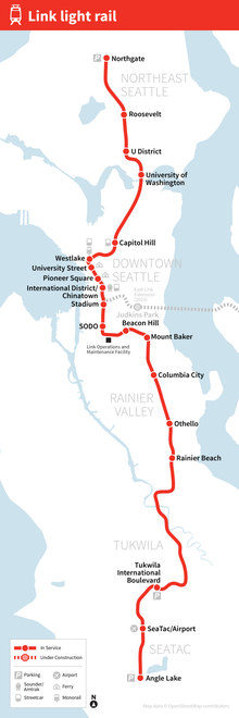 A map depicting the route of the Red Line through Seattle, with stations marked and labeled. An additional dashed line extends further north on the future Northgate extension, with its stations also marked.