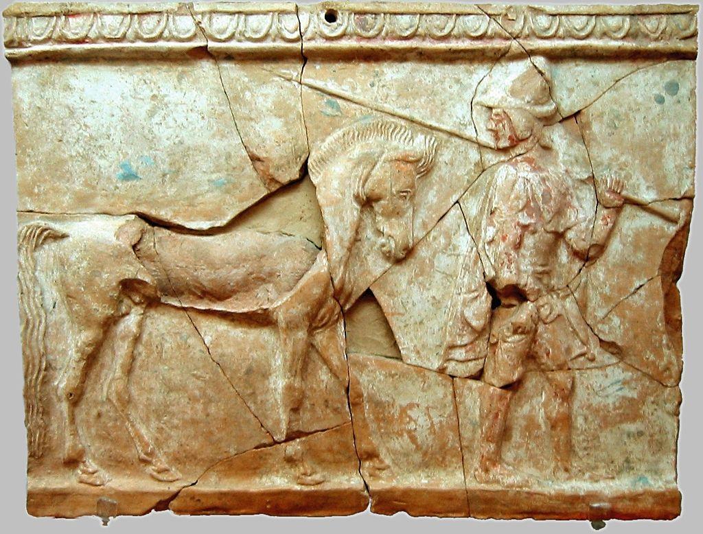 Pinax raffigurante uomo a cavallo.