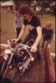 MOTORCYCLIST FROM LEAKEY, TEXAS, LOADS HIS CYCLE ON A TRUCK WITH THE HELP OF FRIENDS NEAR SAN ANTONIO - NARA - 554877.tif