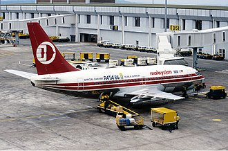 Malaysia Airlines - Malaysian Airline System Boeing 737-200 at Singapore Changi Airport in 1985.