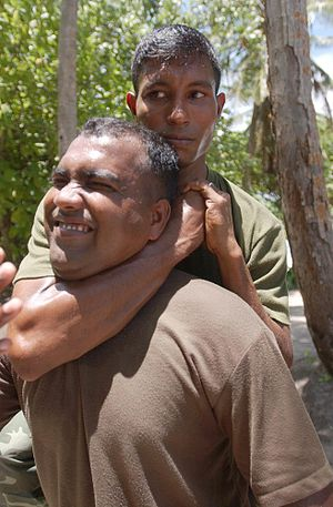 Rear naked choke - Pvt. Abdulla Rasheed, quick reaction force I, National Security Service, Republic of Maldives, executing a sleeper hold variant.