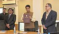 """Manish Tewari releasing the annual report """"Press in India"""" published by the RNI, in New Delhi. The Secretary, Ministry of Information and Broadcasting, Shri Bimal Julka and the Press Registrar, Shri K. Ganesan are also seen.jpg"""
