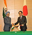 Manmohan Singh and the Prime Minister of Japan, Mr. Naoto Kan exchanging the signed documents of a Joint Statement Vision for India-Japan Strategic and Global Partnership in the next decade, in Tokyo, Japan.jpg