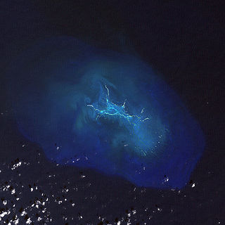 A largely submerged coral atoll in the Northwestern Hawaiian Islands