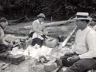 Mary Roberts Rinehart - Mary Roberts Rinehart lunching after a morning's trouting on Flathead River, Glacier National Park (c. 1921)