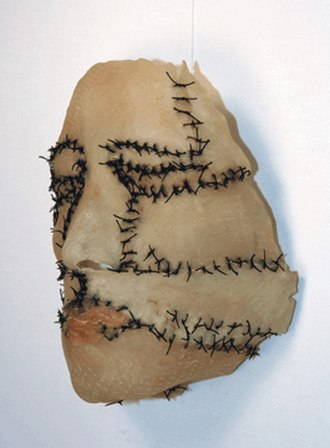 Heide Hatry - Mask, 2004. Preserved pigskin, meat and thread.