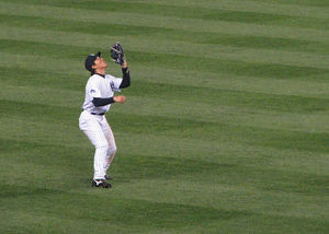 Hideki Matsui catching a fly ball during the Y...